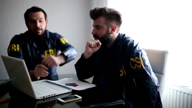 two agents in the office - police chief stock videos and b-roll footage