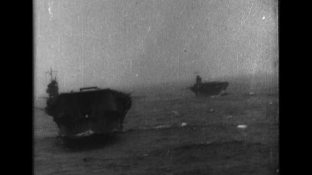 two aircraft carriers of the imperial japanese navy first air fleet sail in the north pacific as their aircraft attack american targets on oahu - north pacific stock videos & royalty-free footage