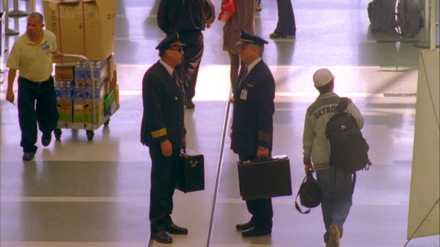 ws two airline pilots greeting and talking in airport, shaking hands and walking away / los angeles, california, usa - pilot stock videos and b-roll footage