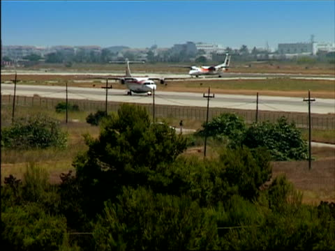 ws, two airplanes taxing, ibiza, spain - stationary process plate stock videos and b-roll footage