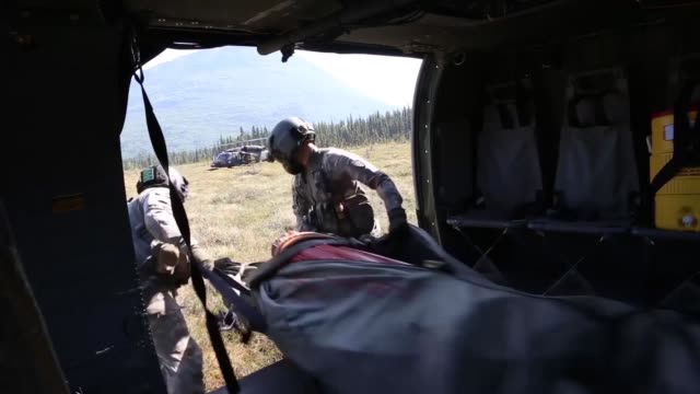 two alaska army national guard uh-60 black hawk helicopters from 1st battalion, 207th aviation regiment, flew a total of 200 bucket missions, dumping... - kenai peninsula stock videos & royalty-free footage