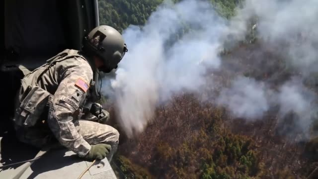 two alaska army national guard uh-60 black hawk helicopters from 1st battalion, 207th aviation regiment, flew a total of 200 bucket missions, dumping... - schießerei stock-videos und b-roll-filmmaterial