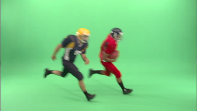 ws, two american football players in studio - wide shot stock videos & royalty-free footage