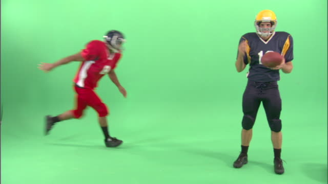 ws, two american football players in studio - tackling stock videos and b-roll footage