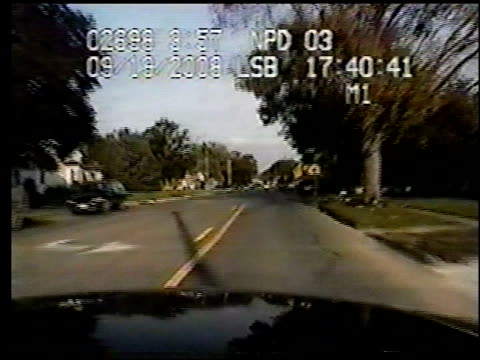 / two angles of color dashcam / police officer racing to the scene and comes upon a man in the street who jumps on the hood of his car with very... - run over stock videos & royalty-free footage