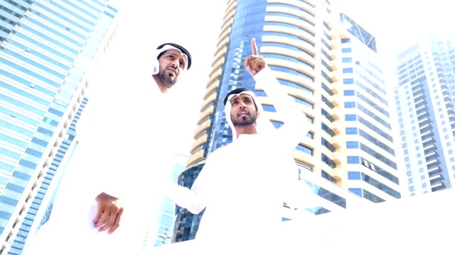 Two arab business people discussing on the street -slowmotion