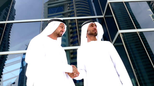 Two arab business people on the street - Stock video