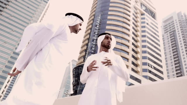 two arab business people on the street - stock video - middle eastern ethnicity stock videos & royalty-free footage
