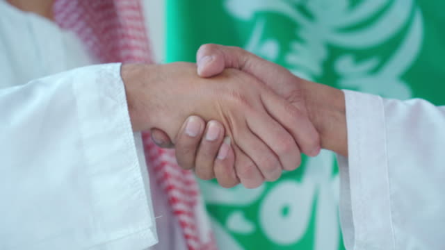 two arab middle east businessman handshake together in office - saudi arabia stock videos & royalty-free footage