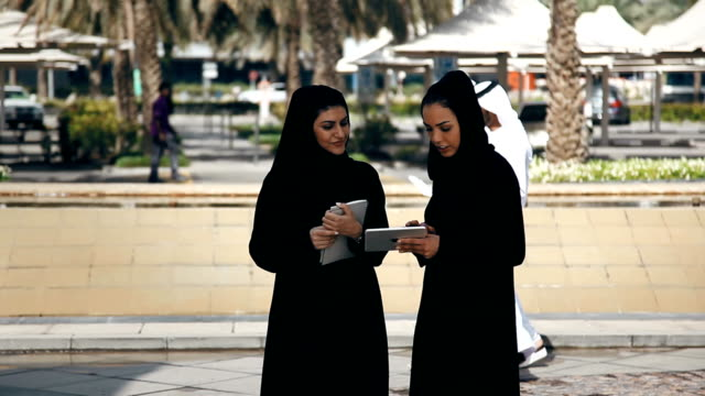 two arabian businesswomen outdoors - middle eastern ethnicity stock videos & royalty-free footage
