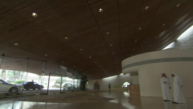 ws td two arabian men standing in lobby / riyadh city, riyadh, saudi arabia - riyadh stock videos & royalty-free footage