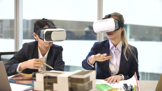 two architecture and engineer using vr glasses for video conference meeting - virtual reality stock videos & royalty-free footage