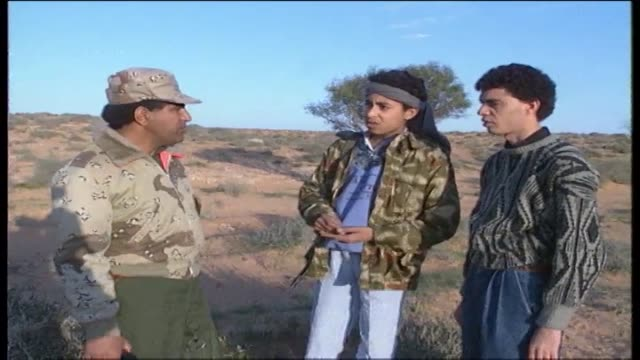 two armed teenage boys walking, talk with military officer. - home movie video stock e b–roll