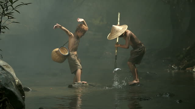 two asian boys are fishing happily at the pond. - at the edge of stock videos & royalty-free footage