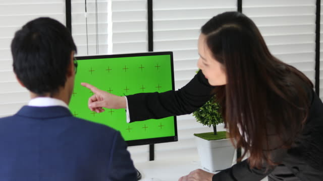 4K: two asian business talking with computer green screen