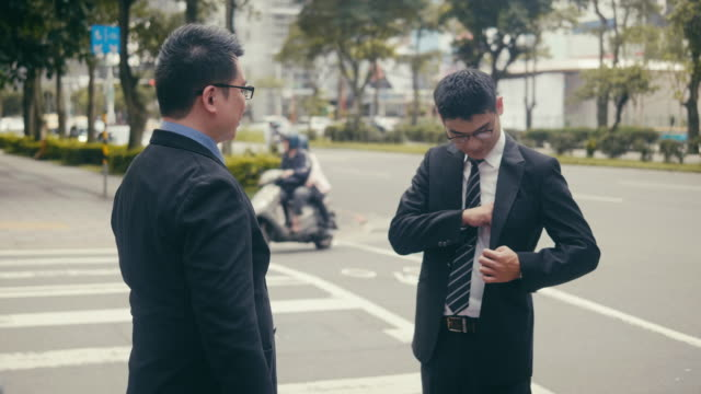 two asian businessmen exchanging business cards in the street - social grace stock videos & royalty-free footage
