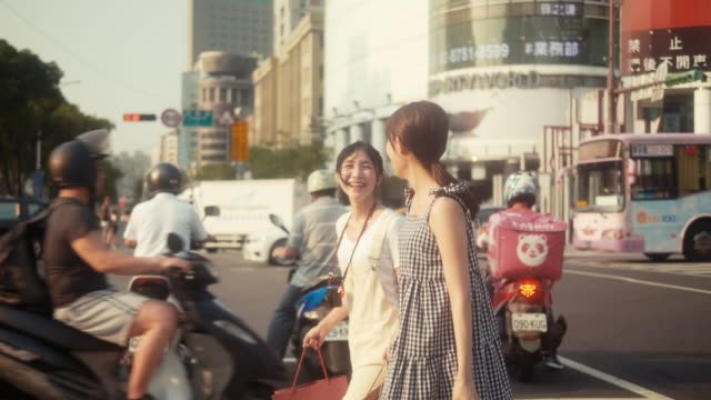 two asian female influencers shopping and crossing street - tracking shot stock videos & royalty-free footage