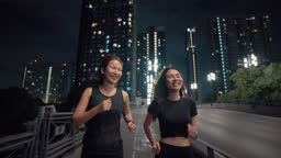 Two Asian woman setting time to exercise for her new session