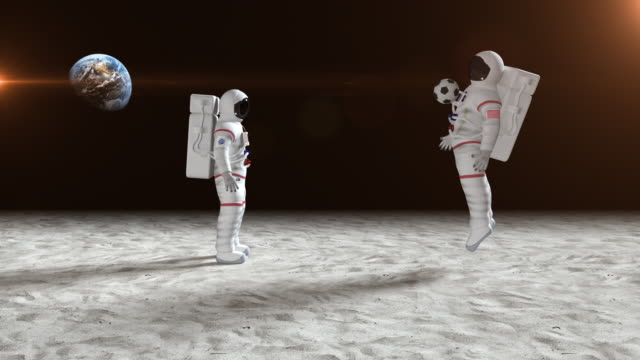 two astronauts playing soccer on the moon surface - moon stock videos & royalty-free footage