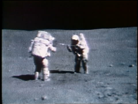 1972 two astronauts taking soil sample on Moon / Apollo 16
