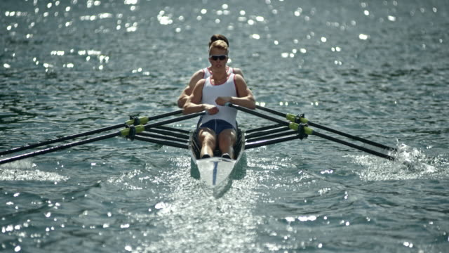 Two athletes rowing in a double scull on a sunny day