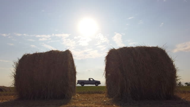 two bales of hay and pick up truck - hay truck stock videos & royalty-free footage