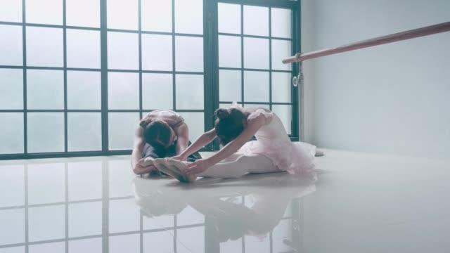 two ballerinas stretching leg - leotard stock videos & royalty-free footage