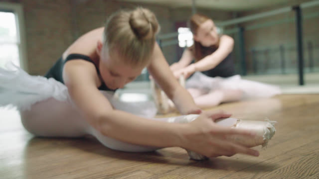 two ballerinas stretching - skirt stock videos & royalty-free footage