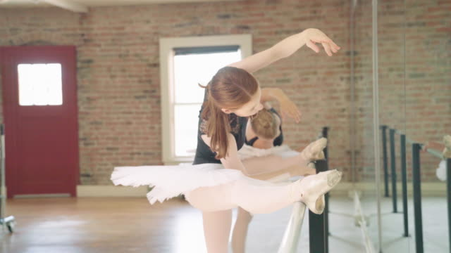 two ballerinas stretching - leotard stock videos and b-roll footage