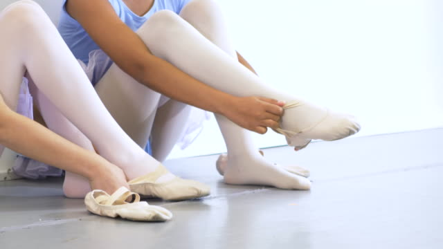 two ballet dancers putting on shoes - 8 9 years stock videos & royalty-free footage