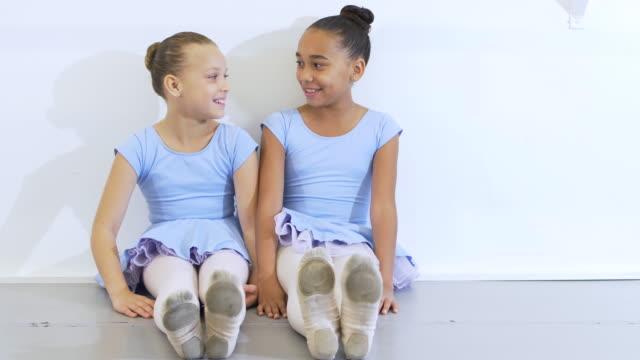 two ballet dancers sitting on floor, conversing - 8 9 years stock videos & royalty-free footage
