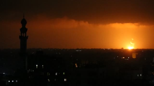 two balls of fire are seen following israel airstrikes at khan yunis in the southern gaza strip early on june 27 - air raid stock videos & royalty-free footage