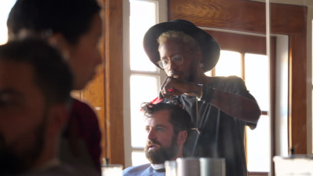 ms two barbers working on clients hair in barber shop - gingham stock videos & royalty-free footage