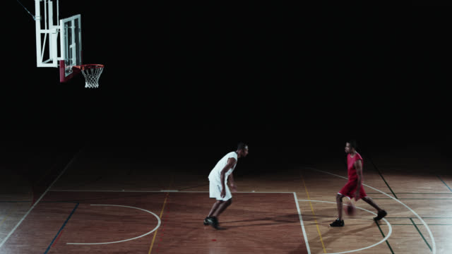 SLO MO of two basketball players playing in free throw lane