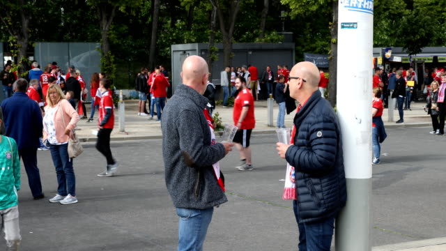 Two Bayern Munich fans are talking with each other prior the DFB Cup final between RB Leipzig and Bayern Muenchen at Olympiastadion on May 25 2019 in...