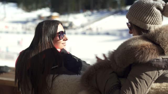 two beautiful women enjoying in a ski cafe - ski holiday stock videos & royalty-free footage