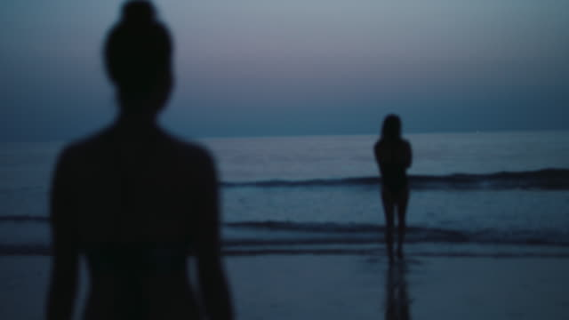 two beautiful women getting ready for a night swim at the ocean in southern france. - anticipation stock videos & royalty-free footage