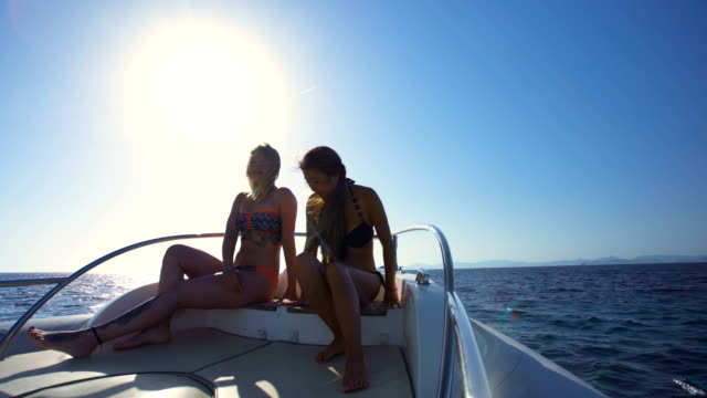 Two beautiful women relaxed in yatch