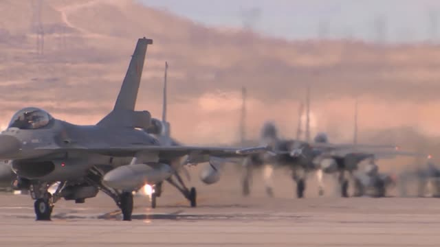 two belgian air force f-16ams taxi to the runway during red flag 14-2 mar 7, 2014 at nellis afb, nev. more than 30 countries have participated... - us airforce stock videos & royalty-free footage