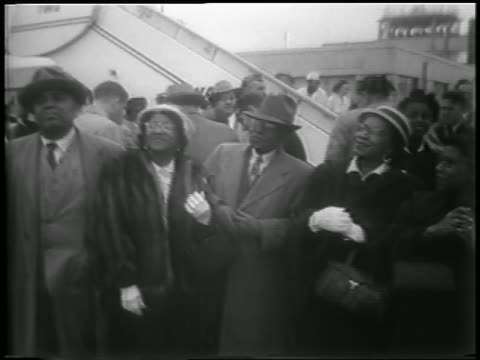 b/w 1953 two black couples waiting looking up anxiously / pow son's homecoming - mature couple stock videos & royalty-free footage