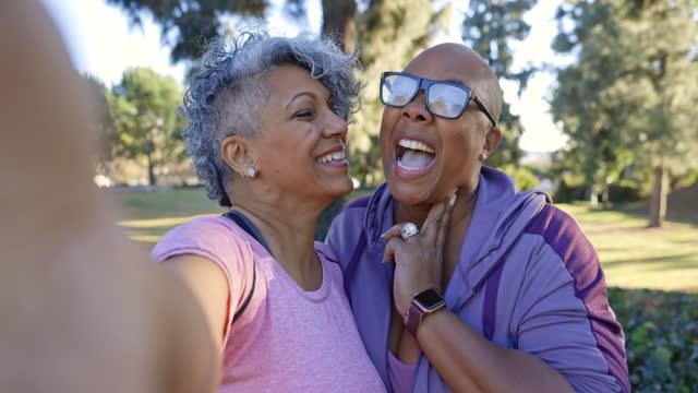 two black lady friends taking selfies - lesbian stock videos & royalty-free footage