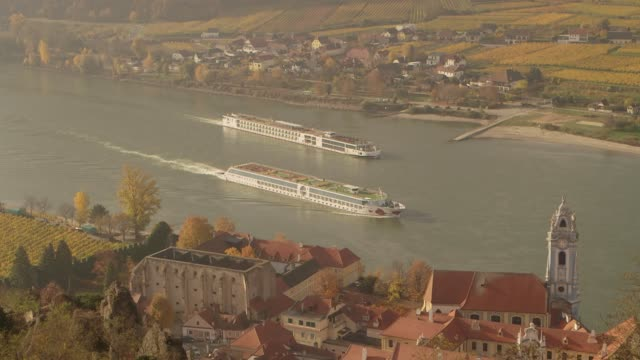 two boats on danube river - durnstein austria - river danube video stock e b–roll