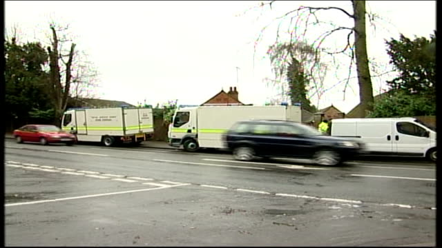 two bomb devices diffused at a house in reading england berkshire reading police bomb disposal unit vans parked in road outside house where two... - {{relatedsearchurl(carousel.phrase)}}点の映像素材/bロール