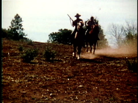 1971 reenactment two bounty hunters on horseback coming to a halt / 19th century united states / audio - mercenary human role stock videos & royalty-free footage