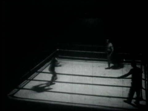 two boxers compete in the boxing ring as referee observes / united states - protective sportswear stock videos & royalty-free footage