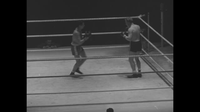 two boxers fighting one knocks the other one down / former heavyweight champion jack dempsey enters ring / dempsey talks to boxers joseph stack and... - boxing ring stock videos & royalty-free footage