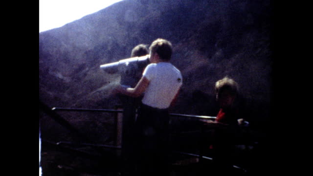 two boys are looking through a scenic telescope at the grand canyon - grand canyon stock videos & royalty-free footage