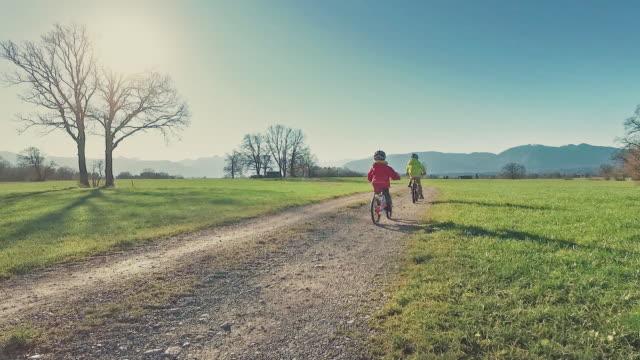 Two boys biking