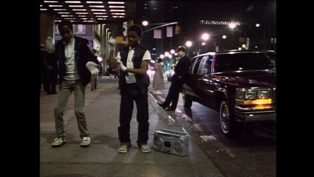 two boys bodypop at night with a boom box; new york, 1984 - bbc archive stock-videos und b-roll-filmmaterial