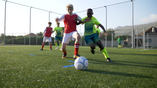 two boys compete and tackle for the soccer ball - tackling stock videos & royalty-free footage